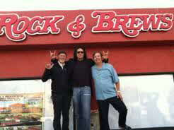 Dave Furano, Gene Simmons and Michael Zislis celebrate the launch of their restaurant venture, Rock & Brews